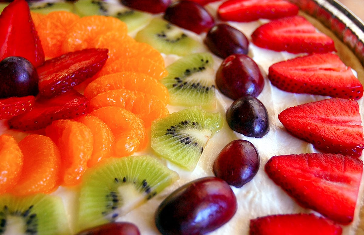 arrangement of various fruit and fruit dip